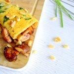 Spinazie egg wrap met gebakken bospaddenstoelen